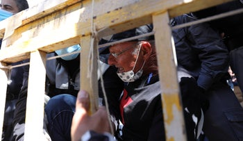 Police forcibly evict Amir Haskel from a protest tent near Netanyahu's official Jerusalem residence, August 2020