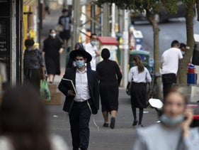 An ultra-Orthodox man walks along the streets of Bnei Brak amid Israel's second nationwide coronavirus lockdown, September 8, 2020