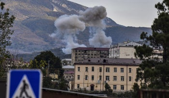 Smoke rises after shelling in Stepanakert on October 9, 2020.