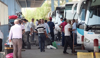 People are seen at the Allenby Bridge border terminal in between the West Bank and Jordan in 2014.
