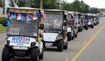 A parade of over 300 golf carts supporting Democratic presidential candidate former Vice President Joe Biden caravanned to the Sumter County Elections office to cast their ballots during early voting Wednesday, Oct. 7, 2020, in The Villages, Fla.