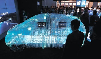 A model of a car displays Intel Mobileye sensor technology at the Intel booth during CES International, in Las Vegas, Nevada, January 9, 2018.