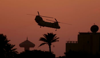 A U.S. Army CH-46 Sea Knight helicopter files over Baghdad's heavily fortified Green Zone, Iraq, February 7, 2007.