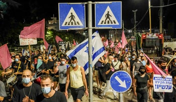 Israelis march against the Netanyahu government in Tel Aviv, October 10, 2020.