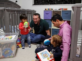 File photo: Elad Dvash-Banks, right, and his partner Andrew, play with their twin sons, Ethan, left, and Aiden in their apartment in Los Angeles, January 23, 2020.
