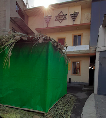 The sukkah (temporary dwelling built for the festival of Sukkot) outside the synagogue in Yerevan, Armenia