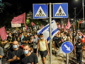 Protesters march in Tel Aviv, October 10, 2020.