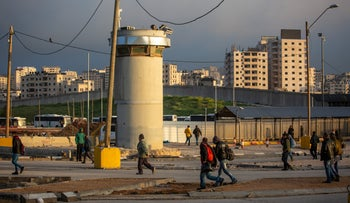 An illustrative photograph of the Kalandiya Checkpoint in the West Bank, north of Jerusalem.