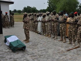 Nigerian soldiers pray during the funeral of fellow servicemen killed in an attack on vehicles carrying Borno governor Babagana Umara Zulum near the town of Baga, Nigeria, September 26, 2020.