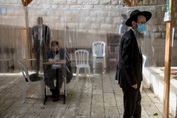 Ultra-Orthodox men praying in a synagogue in Jerusalem, October 13, 2020.