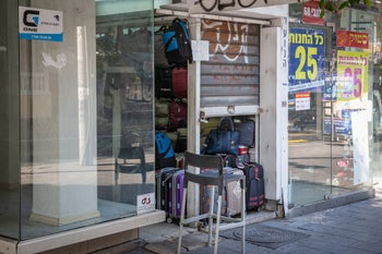 A store conspicuously opened during the lockdown on Ibn Gvirol street, Tel Aviv, October 13, 2020.