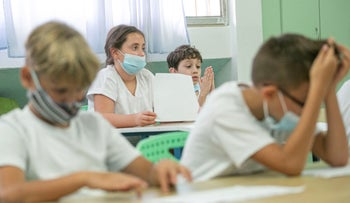 Young students in a classroom at the start of the school year. What will happen to the 120,000 children in Israel who have no computer at home?