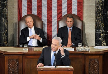 Israel's Prime Minister Benjamin Netanyahu addresses a joint meeting of Congress in Washington, May 24, 2011, with then-House Speaker John Boehner and Vice President Joe Biden watching