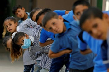 Palestinian students exercising as schools reopen gradually during the coronoavirus crisis, Sussia, West Bank, September 7, 2020.