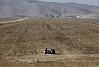 Young men near the unrecognized Bedouin village of Tel Arad in the Negev, October 2020.