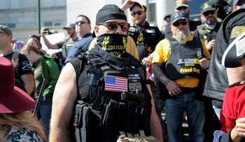 Armed members of the 'Proud Boys' attend a '2nd Amendment' rally at the Michigan Supreme Court Building in Lansing, Michigan, U.S. September 17, 2020.