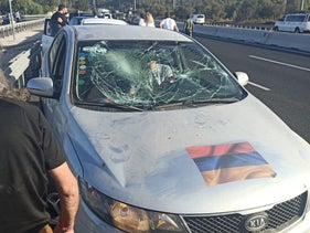 A car displaying the Armenian flag on its hood, its windshield shattered in the midst of a brawl that broke out on an Israeli highway near Jerusalem, October 17, 2020