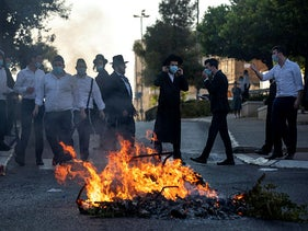 A riot after an ultra-Orthodox woman is arrested for not wearing a mask in the Givat Moshe neighborhood of Jerusalem, October 11, 2020.