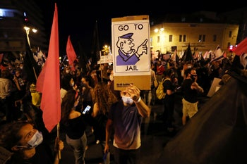 Protesters demonstrating against Prime Minister Benjamin Netanyahu's alleged corruption and his handling of the coronavirus disease (COVID-19) crisis, in Jerusalem, October 17, 2020.