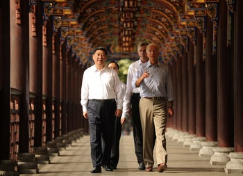 US Vice President Joe Biden and Chinese Vice President Xi Jinping walk across the Dujiangyan Irrigation system in China's southwest province of Sichuan. August 21, 2011.