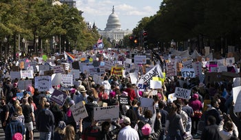 With the U.S Capitol in the back ground demonstrators march on Pennsylvania Avenue during the Women's March in Washington, October 17, 2020.