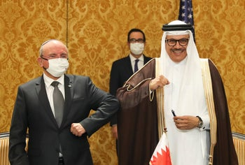 Israel's national security adviser Meir Ben-Shabbat with Bahrain's Foreign Minister Abdullatif al-Zayani after signing an agreement establishing formal diplomatic relations in Bahrain. Oct. 18, 2020