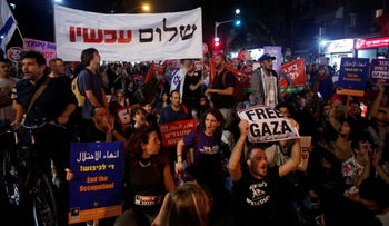 1,000 pro-peace, anti-occupation activists block the road in front of the Likud headquarters building in Tel Aviv to protest Israel's conflict with Hamas in Gaza. April 8, 2018