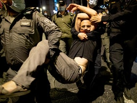 A protester is seen being carried away by police in Jerusalem near the prime minister's residence, October 18, 2020.