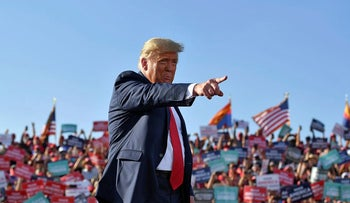US President Donald Trump arrives for a rally at Tucson International Airport in Tucson, Arizona on October 19, 2020