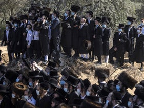 Ultra-Orthodox Jews attend the funeral for Rabbi Mordechai Leifer