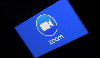 A Zoom App logo is displayed on a smartphone on March 30, 2020 in Arlington, Virginia.
