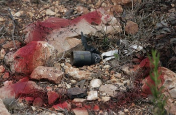 A cluster bomb used by Israel in Lebanon is marked by red painting on the Lebanon-Israeli border road near the southern Lebanese village of Naqura, Thursday, Aug. 31, 2006.