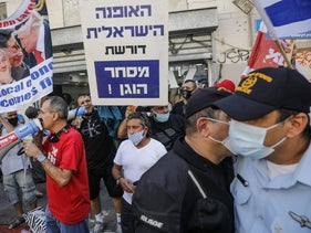 Store owners protest against Israel's second COVID lockdown, Tel Aviv, October 2020.