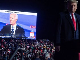 US President Donald Trump watches a video of Democratic presidential nominee former Vice President Joe Biden as he holds a Make America Great Again rally as he campaigns at Erie International Airport in Erie, Pennsylvania, October 20, 2020