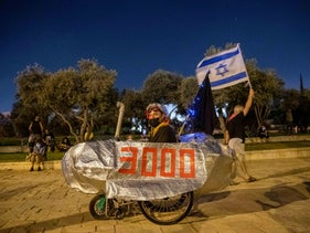 At a demonstration, a bike as vehicle for protest displays the number '3000,' a reference to the submarine corruption affair, dubbed Case 3,000 by the police, Jerusalem, October 14, 2020.