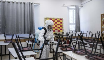 A classroom in Jerusalem's Gymnasia Ivrit high school undergoes disinfection following a super-spreader event, June 3, 2020