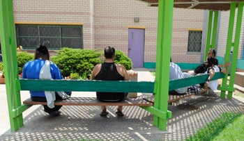 Patients sit in the yard at the Sha'ar Menashe Mental Health Center, in 2016.