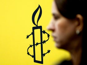 The logo of Amnesty International seen during a news conference in Caracas, February 20, 2019.