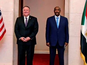 U.S. Secretary of State Mike Pompeo stands with Sudanese Gen. Abdel-Fattah Burhan, the head of the ruling sovereign council, in Khartoum, Sudan, August 25, 2020.