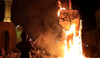 protest symbol that was set on fire by the supporters of former Lebanese Prime Minister Saad Hariri, after a small demonstration had denounced the naming of Hariri as a potential candidate as the country's new prime minister, in downtown Beirut, Lebanon, Wednesday, Oct. 21, 2020