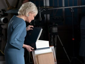 Image of Stahl opening the binder she was given of Trump's successes