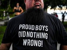 """A supporter of U.S. President Donald Trump wears a """"Proud Boys"""" shirt prior to his arrival for NBC News town hall event at the Perez Art Museum in Miami, October 15, 2020."""