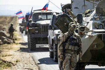 A Russian Military convoy drives near the village of Ein Diwar in Syria's northeastern Hasakeh province on October 11, 2020.