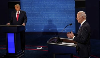 Democratic presidential candidate Joe Biden answers a question as President Donald Trump listens during the second and final presidential debate in Nashville, Tennessee, October, 22, 2020.