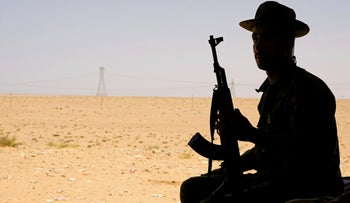 A member of the Libyan National Army commanded by Khalifa Haftar sits in a tent at one of their sites in west of Sirte, August 19, 2020.