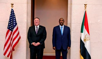 U.S. Secretary of State Mike Pompeo stands with Sudanese Gen. Abdel-Fattah Burhan, the head of the ruling sovereign council, Khartoum, Sudan, August 25, 2020