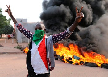 A demonstrator gives the victory sign at a protest, in Khartoum, Sudan, October 21, 2020.