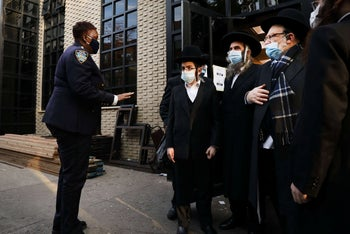 NYPD officers stand outside the Satmar synagogue in Williamsburg, Brooklyn, after NY authorities ordered a Satmar wedding, due to include 10,000 celebrants, be closed down. October 19, 2020.
