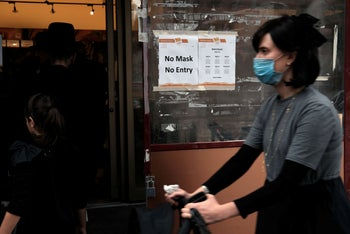 A sign requests customers wear face masks in the Brooklyn neighborhood of Williamsburg, one of numerous Brooklyn neighborhoods witnessing a spike in the number of COVID-19 cases. October 1, 2020.