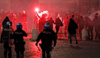 Demonstrators clash with police on Piazza del Popolo square to protest against measures put in place to curb the coronavirus disease (COVID-19) infections in Rome, Italy, October 24, 2020